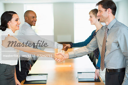 Business people shaking hands in meeting Stock Photo - Premium Royalty-Free, Image code: 6113-07242731