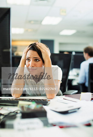 Businesswoman working at desk in office Stock Photo - Premium Royalty-Free, Image code: 6113-07242749
