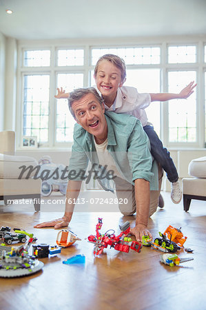 Father and son playing together Stock Photo - Premium Royalty-Free, Image code: 6113-07242820