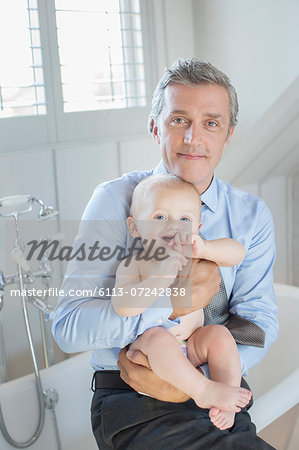 Father holding baby in bathroom Stock Photo - Premium Royalty-Free, Image code: 6113-07242838
