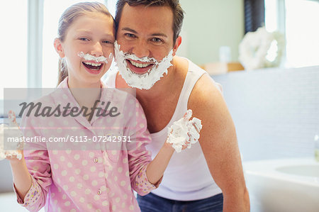 Father and daughter playing with shaving cream Stock Photo - Premium Royalty-Free, Image code: 6113-07242931
