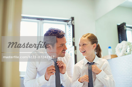 Father and daughter tying ties in bathroom Stock Photo - Premium Royalty-Free, Image code: 6113-07242957