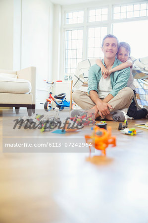 Father and son playing together Stock Photo - Premium Royalty-Free, Image code: 6113-07242964