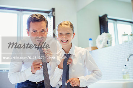 Father and daughter adjusting ties in bathroom Stock Photo - Premium Royalty-Free, Image code: 6113-07242990