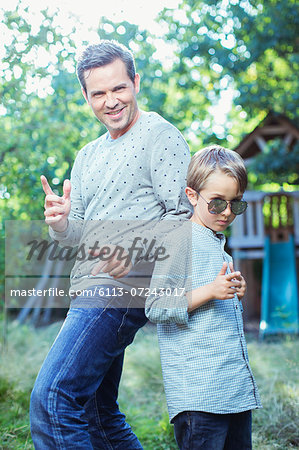 Father and son gesturing outdoors Stock Photo - Premium Royalty-Free, Image code: 6113-07243017