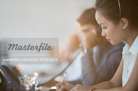 Business people working in office Stock Photo - Premium Royalty-Free, Image code: 6113-07243043