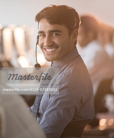 Businessman wearing headset in office Stock Photo - Premium Royalty-Free, Image code: 6113-07243051