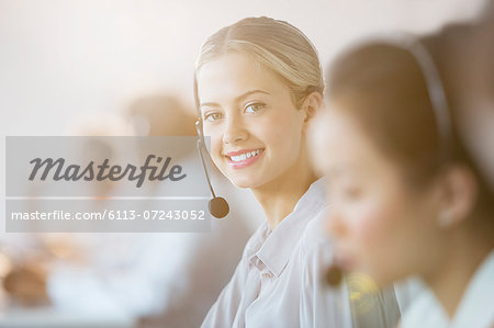 Businesswoman wearing headset in office Stock Photo - Premium Royalty-Free, Image code: 6113-07243052
