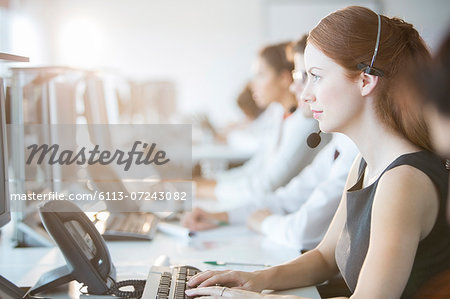 Businesswoman wearing headset in office Stock Photo - Premium Royalty-Free, Image code: 6113-07243082