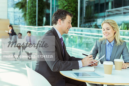 Business people talking in cafe Stock Photo - Premium Royalty-Free, Image code: 6113-07243215