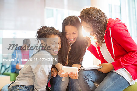 University students taking self-portraits with camera phone Stock Photo - Premium Royalty-Free, Image code: 6113-07243305