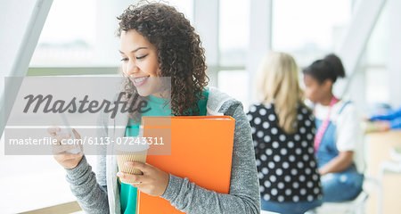 University student using cell phone Stock Photo - Premium Royalty-Free, Image code: 6113-07243311