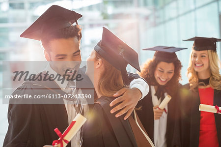 Graduates hugging Stock Photo - Premium Royalty-Free, Image code: 6113-07243390