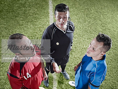Soccer players facing each other on field Stock Photo - Premium Royalty-Free, Image code: 6113-07310567