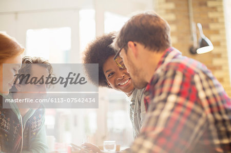 Friends talking in cafe Stock Photo - Premium Royalty-Free, Image code: 6113-07542434