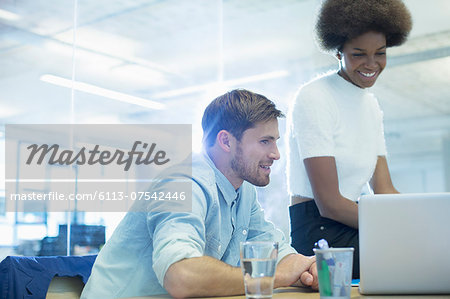Business people using laptop in office Stock Photo - Premium Royalty-Free, Image code: 6113-07542446