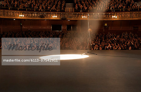 Spotlight shining on stage in theater Stock Photo - Premium Royalty-Free, Image code: 6113-07542911