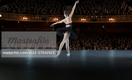 Ballerina performing on stage in theater Stock Photo - Premium Royalty-Free, Image code: 6113-07542923