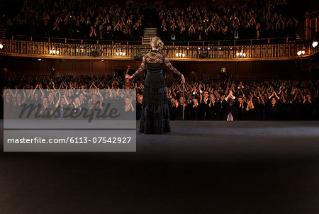 Violinist  performing on stage in theater Stock Photo - Premium Royalty-Free, Image code: 6113-07542927