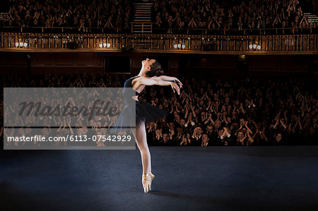 Ballerina performing on stage in theater Stock Photo - Premium Royalty-Free, Image code: 6113-07542929