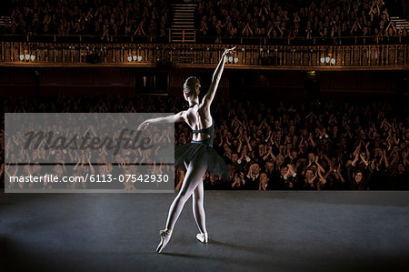 Ballerina performing on stage in theater Stock Photo - Premium Royalty-Free, Image code: 6113-07542930