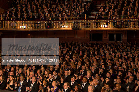 Audience applauding in theater Stock Photo - Premium Royalty-Free, Image code: 6113-07542931