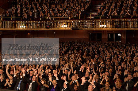 Audience cheering in theater Stock Photo - Premium Royalty-Free, Image code: 6113-07542932