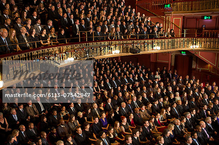 Audience watching performance in theater Stock Photo - Premium Royalty-Free, Image code: 6113-07542947