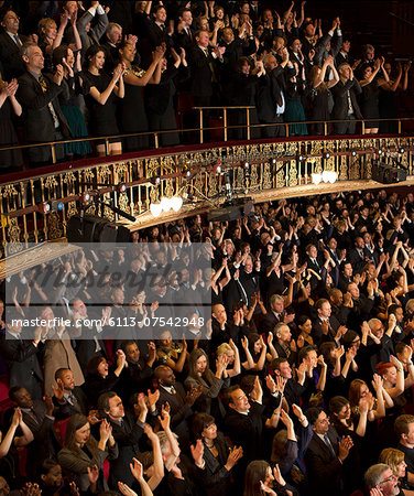 Audience applauding in theater Stock Photo - Premium Royalty-Free, Image code: 6113-07542948