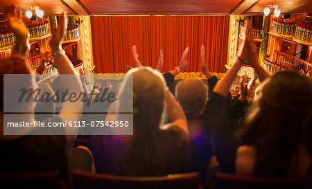 Audience clapping in theater Stock Photo - Premium Royalty-Free, Image code: 6113-07542950