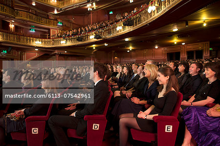 Audience watching performance in theater Stock Photo - Premium Royalty-Free, Image code: 6113-07542961