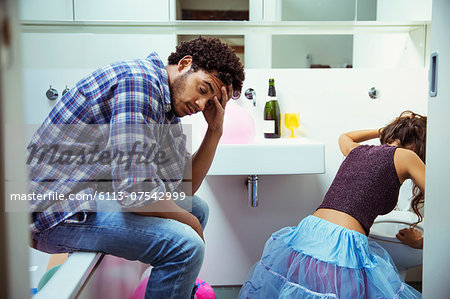 Drunk couple in bathroom at party Stock Photo - Premium Royalty-Free, Image code: 6113-07542999