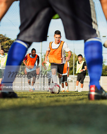 Soccer players training on field Stock Photo - Premium Royalty-Free, Image code: 6113-07543119