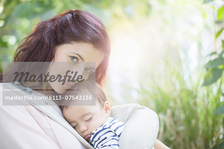 Mother holding baby girl outdoors Stock Photo - Premium Royalty-Free, Image code: 6113-07543136