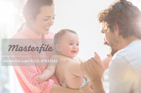 Parents playing with baby boy Stock Photo - Premium Royalty-Free, Image code: 6113-07543142