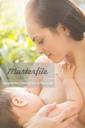 Mother breast-feeding baby boy Stock Photo - Premium Royalty-Free, Image code: 6113-07543148