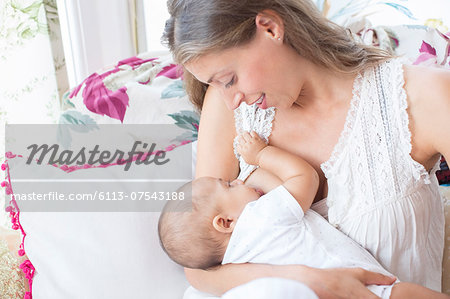 Mother breast-feeding baby boy Stock Photo - Premium Royalty-Free, Image code: 6113-07543188