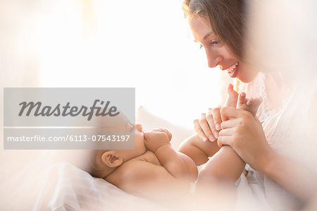 Mother playing with baby boy Stock Photo - Premium Royalty-Free, Image code: 6113-07543197