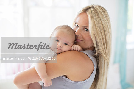 Mother holding baby girl Stock Photo - Premium Royalty-Free, Image code: 6113-07543200
