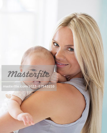 Mother holding baby girl Stock Photo - Premium Royalty-Free, Image code: 6113-07543210