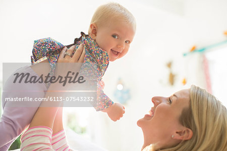 Mother playing with baby girl Stock Photo - Premium Royalty-Free, Image code: 6113-07543232