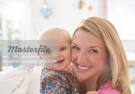 Mother holding baby girl Stock Photo - Premium Royalty-Free, Image code: 6113-07543239