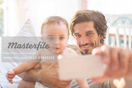 Father taking self-portrait with baby boy Stock Photo - Premium Royalty-Free, Image code: 6113-07543243