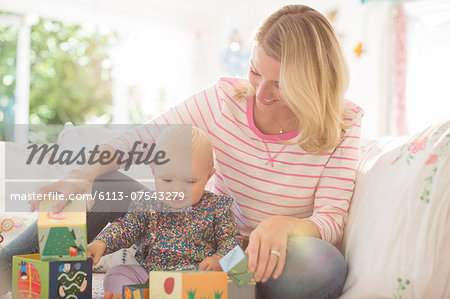 Mother and baby girl playing with blocks Stock Photo - Premium Royalty-Free, Image code: 6113-07543279