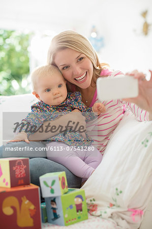 Mother taking self-portrait with baby girl Stock Photo - Premium Royalty-Free, Image code: 6113-07543280