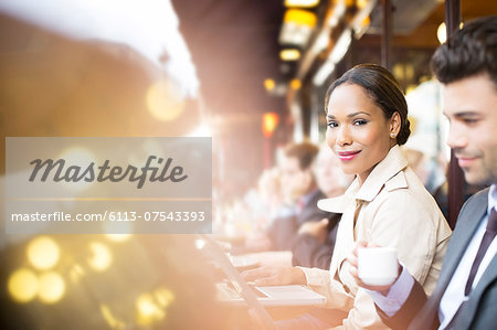 Business people working at sidewalk cafe Stock Photo - Premium Royalty-Free, Image code: 6113-07543393