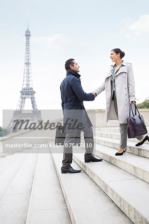 Business people shaking hands by Eiffel Tower, Paris, France Stock Photo - Premium Royalty-Free, Image code: 6113-07543410