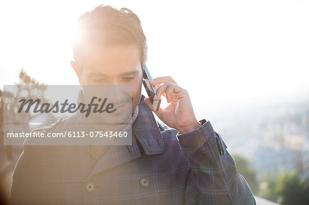 Businessman talking on cell phone Stock Photo - Premium Royalty-Free, Image code: 6113-07543460