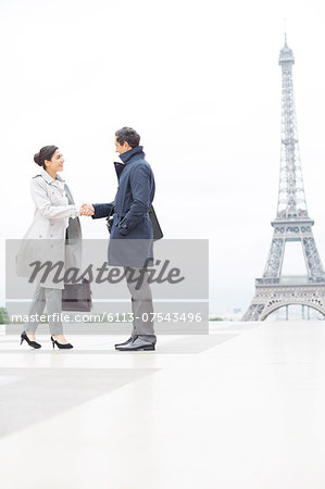Business people shaking hands near Eiffel Tower, Paris, France Stock Photo - Premium Royalty-Free, Image code: 6113-07543496