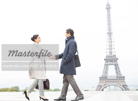 Business people shaking hands near Eiffel Tower, Paris, France Stock Photo - Premium Royalty-Free, Image code: 6113-07543519